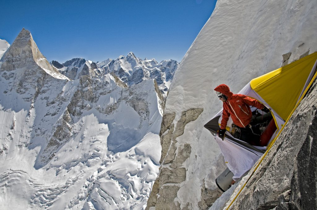 Renan Ozturk looking out of the portalege, 2008 Meru Expedition, Garwhal, India